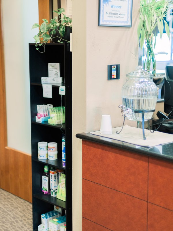 Medical cabinet beside reception area with water jug at Eugene Dental Group